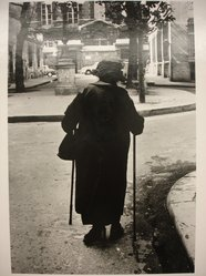 Sidney Kerner (American, 1920-2013). <em>Woman with Two Canes (Paris)</em>, 1969. Gelatin silver photograph, sheet: 14 × 10 7/8 in. (35.6 × 27.6 cm). Brooklyn Museum, Gift of Anna Bisso, 81.147.4. © artist or artist's estate (Photo: Brooklyn Museum, CUR.81.147.4.jpg)