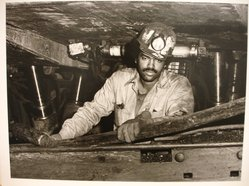 Builder Levy (American, born 1942). <em>Dave Moore Working on the Longwall Keystone #5 Mine, Eastern Associated Coal Co., Affinity, W. Va., 1982</em>, 1982. Toned gelatin silver photograph, sheet: 10 7/8 × 14 in. (27.6 × 35.6 cm). Brooklyn Museum, Gift of Harold and Vivian Levy, 85.189.3. © artist or artist's estate (Photo: Brooklyn Museum, CUR.85.189.3.jpg)