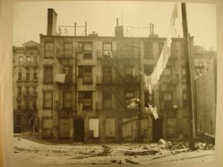 Arnold Eagle (American, born Hungary, 1914-1992). <em>Black Houses on Lower East Side</em>, ca. 1936. Gelatin silver photograph, image/sheet: 10 1/2 x 13 1/8 in. (26.7 x 33.3 cm). Brooklyn Museum, Gift of David Garfinkel, 87.244.4. © artist or artist's estate (Photo: Brooklyn Museum, CUR.87.244.4.jpg)