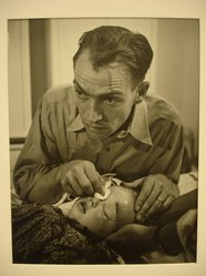 W. Eugene Smith (American, 1918-1978). <em>[Untitled] (Dr. Ernest Ceriani Swabbing Eye of Child)</em>, 1948. Gelatin silver photograph, Sheet: 13 7/8 x 10 7/8 in. (35.2 x 27.6 cm). Brooklyn Museum, Gift of Philip Goutell, 87.245.15. © artist or artist's estate (Photo: Brooklyn Museum, CUR.87.245.15.jpg)