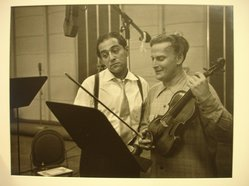 W. Eugene Smith (American, 1918-1978). <em>[Untitled] (Robert Merrill and Yehudi Menuhin)</em>, 1951-1952. Gelatin silver photograph, Sheet: 11 x 13 7/8 in. (27.9 x 35.2 cm). Brooklyn Museum, Gift of Philip Goutell, 87.245.18. © artist or artist's estate (Photo: Brooklyn Museum, CUR.87.245.18.jpg)