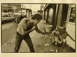 Ethel Wolvovitz (American, born 1946). <em>Boy Vs. Dog</em>, 1986. Gelatin silver photograph, Sheet: 11 x 14 in.  (27.9 x 35.6 cm). Brooklyn Museum, Gift of the artist, 87.52.3. © artist or artist's estate (Photo: Brooklyn Museum, CUR.87.52.3.jpg)